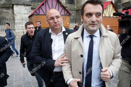 Florian Philippot, right, a vice-president of the National Front party, is escorted outside the Reims cathedral, east of Paris, while far-right presidential candidate Marine Le Pen visits the cathedral . Le Pen acknowledged Friday that she was angry during this week's presidential debate against her centrist rival, but said she was merely channeling the anger she sees throughout the country