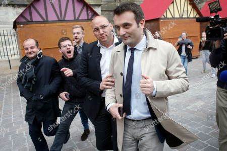Florian Philippot, right, a vice-president of the National Front party, is escorted with David Rachline, left, campaign director for Marine le Pen, outside the Reims cathedral, east of Paris, while far-right presidential candidate Marine Le Pen visits the cathedral . Le Pen acknowledged Friday that she was angry during this week's presidential debate against her centrist rival, but said she was merely channeling the anger she sees throughout the country
