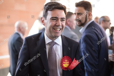 Andy Burnham is congratulated by Afzal Khan after winning the race, at the declaration. The count for council and Metro Mayor elections in Greater Manchester at the Manchester Central Convention Centre.
