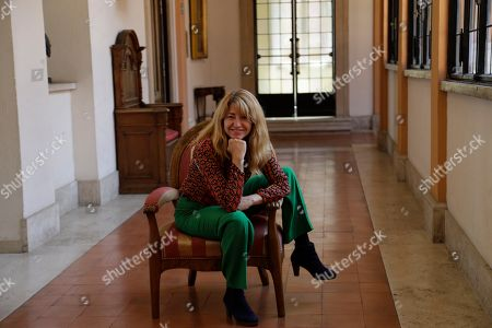 """Spanish director Ines Paris poses for photographers during a photo call presenting the movie """"La noche que mi madre mató a mi padre""""(The Night That My Mother Killed My Father) on the occasion of the Spanish Film Festival in Rome"""