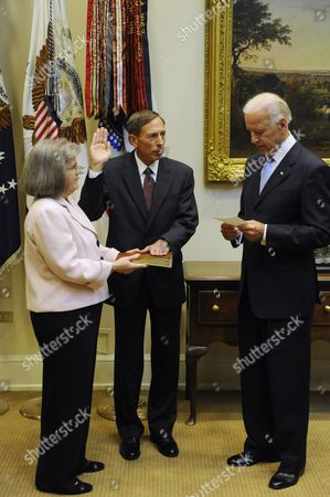 Us Vice President Joe Biden (r) Swears in General David Petraeus (c) As Director of the Central Intelligence Agency (cia) As Holly Petraeus (l) Looks on in the Roosevelt Room of the White House in Washington Dc Usa 06 September 2011 United States Washington