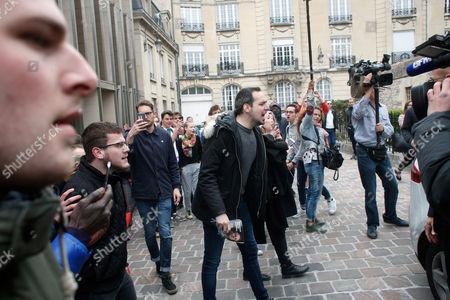 A man shouts on Florian Philippot, a vice-president of the National Front party, outside the Reims cathedral, east of Paris, while far-right presidential candidate Marine Le Pen visits the cathedral . Le Pen acknowledged Friday that she was angry during this week's presidential debate against her centrist rival, but said she was merely channeling the anger she sees throughout the country