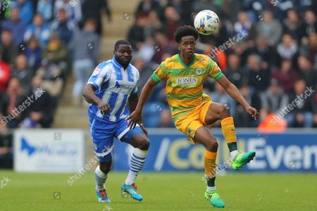 Shayon Harrison of Yeovil Town controls the ball under pressure from George Elokobi of Colchester United - Colchester United v Yeovil Town, Sky Bet League Two, Weston Homes Community Stadium, Colchester - 6th May 2017.