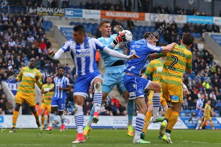Stock Picture of Johnny Maddison of Yeovil Town collects the ball under pressure from Chris Porter and Matthew Briggs of Colchester United - Colchester United v Yeovil Town, Sky Bet League Two, Weston Homes Community Stadium, Colchester - 6th May 2017.