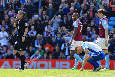 Steve Sidwell of Brighton & Hove Albion falls to the floor as the referee blows the final whistle - Aston Villa v Brighton and Hove Albion, Sky Bet Championship, Villa Park, Birmingham - 7th May 2017.