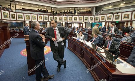 Tom Lee, Richard Corcoran Senator Tom Lee, right, R- Brandon, talks with Speaker of the House Richard Corcoran, R-Land O' Lakes, on the House floor during late negotiations at the Florida Capitol in Tallahassee, Fla