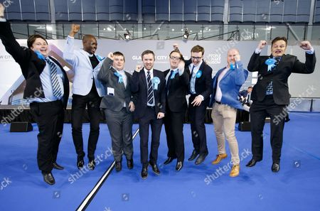 Winning Conservative councillors (L to R):  Kyle Thornton, Ade Aibinu, Robert Connolly, David Meikle, Thomas Kerr, Euan Blockley, Tony Curtis and Philip Charlesat the local council elections count at the Emirates Arena , Glasgow, Scotland, 05 May 2017.