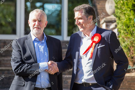 Jeremy Corbyn, Leader of the Labour Party, shakes hands with newly elected Metro Mayor of Liverpool Steve Rotheram, at Devonshire House Hotel