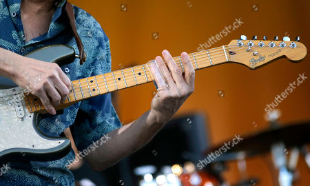 Blues guitarist Sonny Landreth plays the slide guitar at the New Orleans Jazz and Heritage Festival in New Orleans