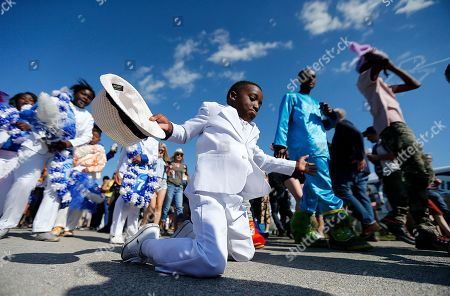 Sonny Landreth Young members of the Original Big Seven Junior Steppers dance during a second line at the New Orleans Jazz and Heritage Festival in New Orleans