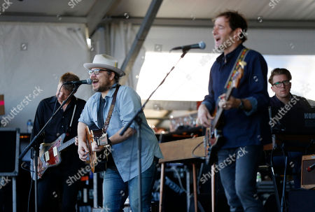 Nels Cline, Jeff Tweedy, John Stirratt, Mikael Jorgensen Guitarist Nels Cline, left, frontman Jeff Tweedy, second left, bassist John Stirratt, and keyboardist Mikael Jorgensen, right, of Wilco, perform with the band at the New Orleans Jazz and Heritage Festival in New Orleans