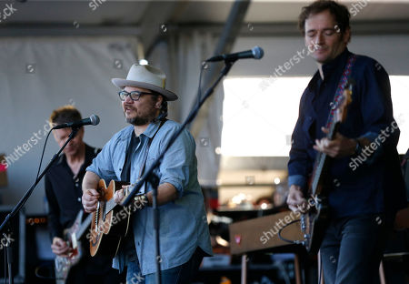 Nels Cline, Jeff Tweedy, John Stirratt Guitarist Nels Cline, left, frontman Jeff Tweedy, center, and bassist John Stirratt, of Wilco, perform with the band at the New Orleans Jazz and Heritage Festival in New Orleans