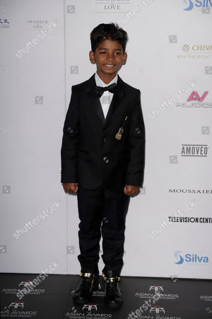 Indian child actor Sunny Pawar poses for photographers as he arrives for the seventh annual Asian Awards at the London Hilton on Park Lane hotel in London