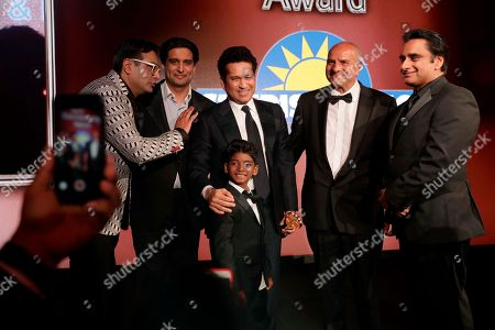 SACHIN TENDULKAR, Sunny Pawar Former Indian cricketer SACHIN TENDULKAR, center, poses for photographs on stage with Indian child actor Sunny Pawar after Tendulkar was presented his Fellowship award at the seventh annual Asian Awards at the London Hilton on Park Lane hotel in London