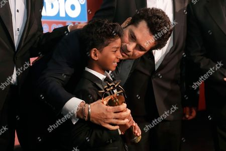 Sunny Pawar, SACHIN TENDULKAR Former Indian cricketer SACHIN TENDULKAR poses for photographs on stage with Indian child actor Sunny Pawar after Tendulkar was presented his Fellowship award at the seventh annual Asian Awards at the London Hilton on Park Lane hotel in London