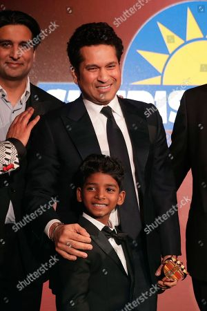 SACHIN TENDULKAR, Sunny Pawar Former Indian cricketer SACHIN TENDULKAR, second left, poses for photographs on stage with Indian child actor Sunny Pawar after Tendulkar was presented his Fellowship award at the seventh annual Asian Awards at the London Hilton on Park Lane hotel in London