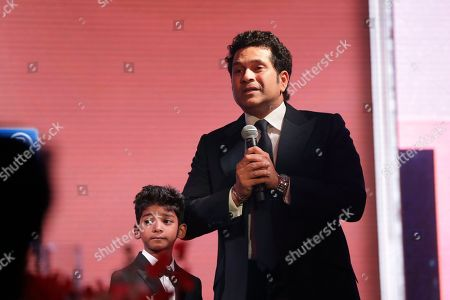 Sunny Pawar, SACHIN TENDULKAR Former Indian cricketer SACHIN TENDULKAR makes a speech on stage flanked by Indian child actor Sunny Pawar after Tendulkar was presented his Fellowship award at the seventh annual Asian Awards at the London Hilton on Park Lane hotel in London