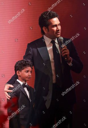 Sachin Tendulkar, Sunny Pawar Former Indian cricketer Sachin Tendulkar, makes a speech on stage flanked by Indian child actor Sunny Pawar after Tendulkar was presented his Fellowship Award at the seventh annual Asian Awards at the London Hilton on Park Lane hotel in London