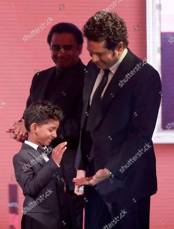 Sachin Tendulkar, Sunny Pawar Former Indian cricketer Sachin Tendulkar, right, holds out his hand to be high-fived by Indian child actor Sunny Pawar at the end of Tendulkar's speech on stage after he was presented his Fellowship award at the seventh annual Asian Awards at the London Hilton on Park Lane hotel in London