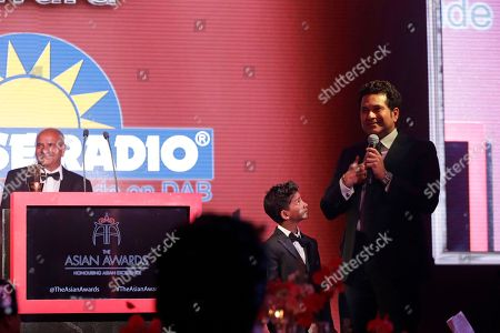 Sachin Tendulkar, Sunny Pawar Former Indian cricketer Sachin Tendulkar makes a speech on stage flanked by Indian child actor Sunny Pawar after Tendulkar was presented his Fellowship award at the seventh annual Asian Awards at the London Hilton on Park Lane hotel in London