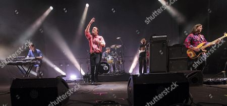 US' band 'Future Islands' members, singer Samuel T Herring (2-L), keyboard player Gerrit Welmers (L) and bassit Willians Cashion (R) perform on stage during the 'We are Murcia' (WAM) Festival opening day held at the 'La Fica' exhibition site in Murcia, southeastern Spain, 05 May 2017.