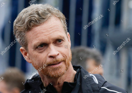 Nike CEO and President Mark Parker talks at the finish line of a 2 hours marathon, at the Monza Formula One racetrack, Italy
