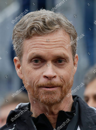 Stock Photo of Nike CEO and President Mark Parker talks at the finish line of a 2 hours marathon, at the Monza Formula One racetrack, Italy