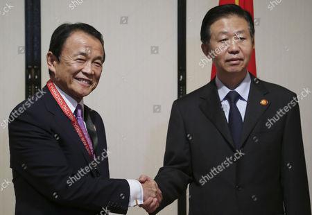 Xiao Jie and Taro Aso