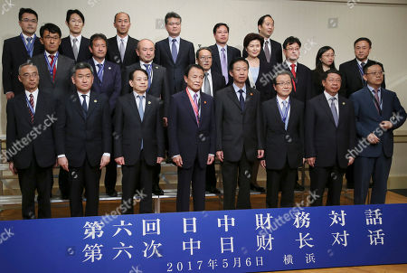 Xiao Jie, Taro Aso Chinese Finance Minister Xiao Jie, front row fourth from right, Japanese Finance Minister Taro Aso front row fourth from left pose for photo with Japan and China's executives of Finance Ministry and Central Bank during their meeting in Yokohama, near Tokyo