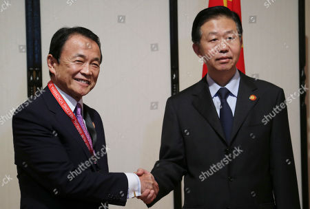 Xiao Jie, Taro Aso Chinese Finance Minister Xiao Jie, right, shakes hands with his Japanese counterpart Taro Aso prior to their meeting in Yokohama, near Tokyo, . They are in Yokohama to attend the Asia Development Bank (ADB) annual meeting