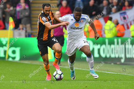 Hull City midfielder Ahmed Elmohamady (27) and Victor Anichebe (28) Sunderland  during the Premier League match between Hull City and Sunderland at the KCOM Stadium, Kingston upon Hull