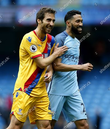 Mathieu Flamini of Crystal Palace shares a joke with compatriot Gael Clichy of Manchester City at full time