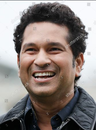 Indian former cricket player Sachin Tendulkar smiles as he walks around the pitch at the Oval cricket ground to promote his upcoming film, in London, . The film, Sachin: A Billion Dreams is an Indian biographical film written and directed by James Erskine and produced by Ravi Bhagchandka. The film, based on the life of Tendulkar will be released on May 26