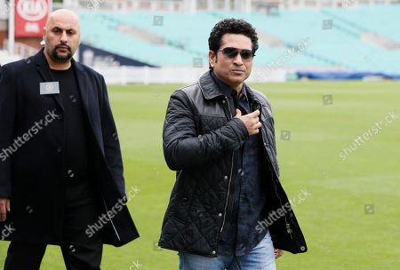 Indian former cricket player Sachin Tendulkar is escorted by a security officer as he arrives at the Oval cricket ground to promote his upcoming film, in London, . The film, Sachin: A Billion Dreams is an Indian biographical film written and directed by James Erskine and produced by Ravi Bhagchandka. The film, based on the life of Tendulkar will be released on May 26