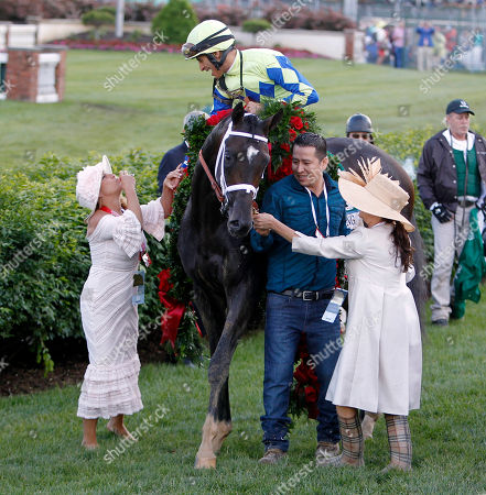 John Velazquez celebrates with owners Mary Ellen Bonomo and Teresa Viola after Velazquez rode Always Dreaming to victory in the 143rd running of the Kentucky Derby horse race at Churchill Downs, in Louisville, Ky