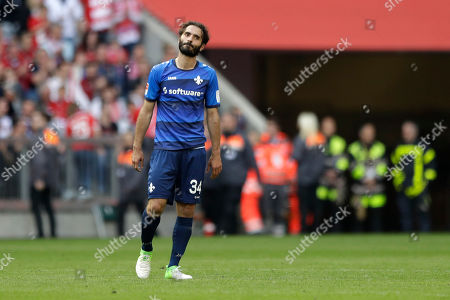 Darmstadt's Hamit Altintop stands on the pitch after the German Soccer Bundesliga match between FC Bayern Munich and SV Darmstadt 98 at the Allianz Arena stadium in Munich, Germany
