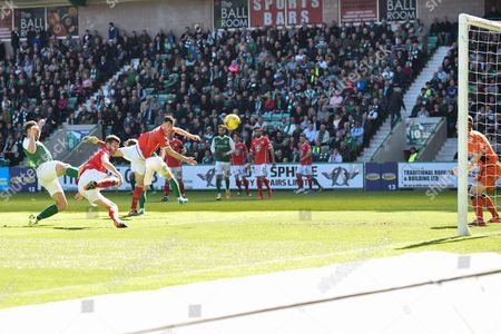 Hibs' Grant Holt scores opening goal at the start of the second half of the Ladbrokes Scottish Championship match between Hibernian and St Mirren at Easter Road, Edinburgh