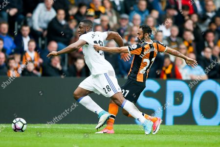 Stock Photo of Sunderland forward Victor Anichebe (28) is held by Hull City midfielder Ahmed Elmohamady (27)  during the Premier League match between Hull City and Sunderland at the KCOM Stadium, Kingston upon Hull