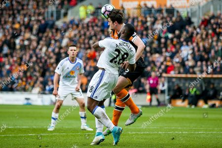 Stock Picture of Sunderland forward Victor Anichebe (28) is out muscled by Hull City defender Harry Maguire (5)  during the Premier League match between Hull City and Sunderland at the KCOM Stadium, Kingston upon Hull