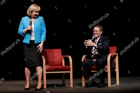 """Former """"Saturday Night Live"""" comedian and Joe Piscopo, right, talks to reporters during a news conference with New Jersey Lt. Gov. Kim Guadagno at Bergen County College, in Paramus, N.J. Piscopo announced he will not be launching an independent campaign to succeed Republican Gov. Chris Christie and will endorse Guadagno during her bid in the primary elections for gubernatorial race"""