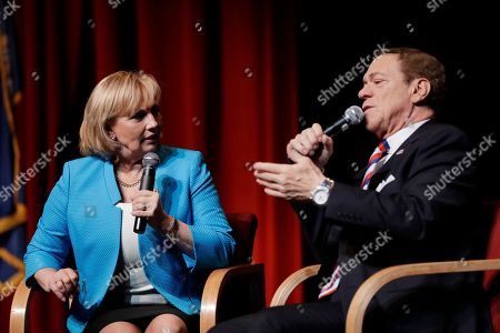 """Stock Photo of Former """"Saturday Night Live"""" comedian and Joe Piscopo, right, talks to reporters during a news conference with New Jersey Lt. Gov. Kim Guadagno at Bergen County College, in Paramus, N.J. Piscopo announced he will not be launching an independent campaign to succeed Republican Gov. Chris Christie and will endorse Guadagno during her bid in the primary elections for gubernatorial race"""