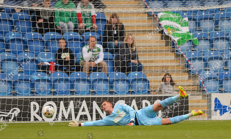 Johnny Maddison Of Yeovil Town in goal fails to deny Tariqe Fosu Of Colchester United (out of pic) long range shot to make it 1-0 during the Sky Bet League 2 Match between Colchester United and Yeovil Town at The Weston Homes Community Stadium, Colchester, Essex on May 6.