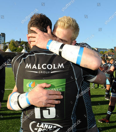 Sean Lamont - Glasgow winger hugs Alex Dunbar after playing his last game before retiring.