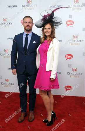 Stephen Amell, Cassandra Jean Stephen Amell and Cassandra Jean walk the Kentucky Derby red carpet, at Churchill Downs in Louisville, Ky. Longines, the Swiss watch manufacturer known for its luxury timepieces, is the Official Watch and Timekeeper of the 143rd annual Kentucky Derby