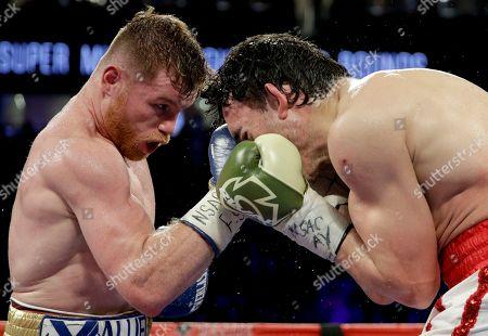 Canelo Alvarez, Julio Cesar Chavez Jr Canelo Alvarez, left, of Mexico, hits Julio Cesar Chavez Jr., of Mexico, during their catch weight boxing match, in Las Vegas