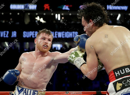 Julio Cesar Chavez Jr., Canelo Alvarez Canelo Alvarez, left, of Mexico, fights Julio Cesar Chavez Jr., of Mexico, during their catch weight boxing match, in Las Vegas