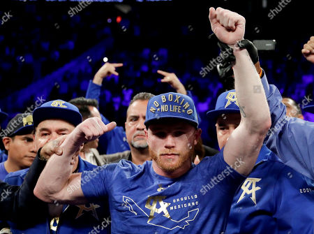 Canelo Alvarez, of Mexico, celebrates his win against Julio Cesar Chavez Jr., of Mexico, during their catch weight boxing match, in Las Vegas