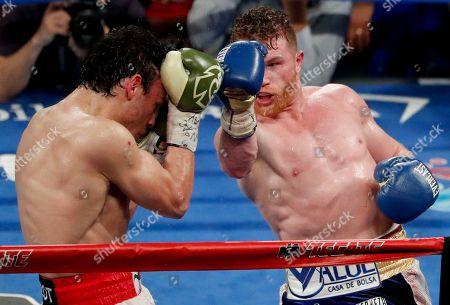 Julio Cesar Chavez Jr., Canelo Alvarez Canelo Alvarez, right, of Mexico, fights Julio Cesar Chavez Jr., of Mexico, during their catch weight boxing match, in Las Vegas