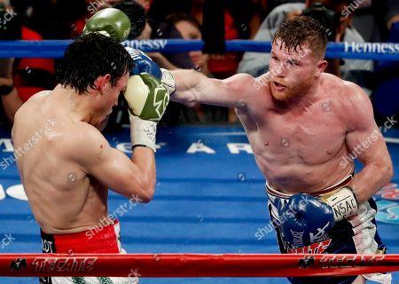Julio Cesar Chavez Jr., Canelo Alvarez Canelo Alvarez, right, of Mexico, hits Julio Cesar Chavez Jr., of Mexico, during their catch weight boxing match, in Las Vegas