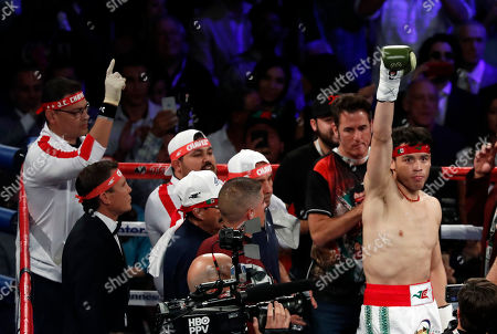Julio Cesar Chavez Jr., of Mexico, right, takes to the ring before his fight against Canelo Alvarez, of Mexico, in Las Vegas